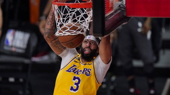 Lakers whip injury-plagued Heat in NBA Finals opener